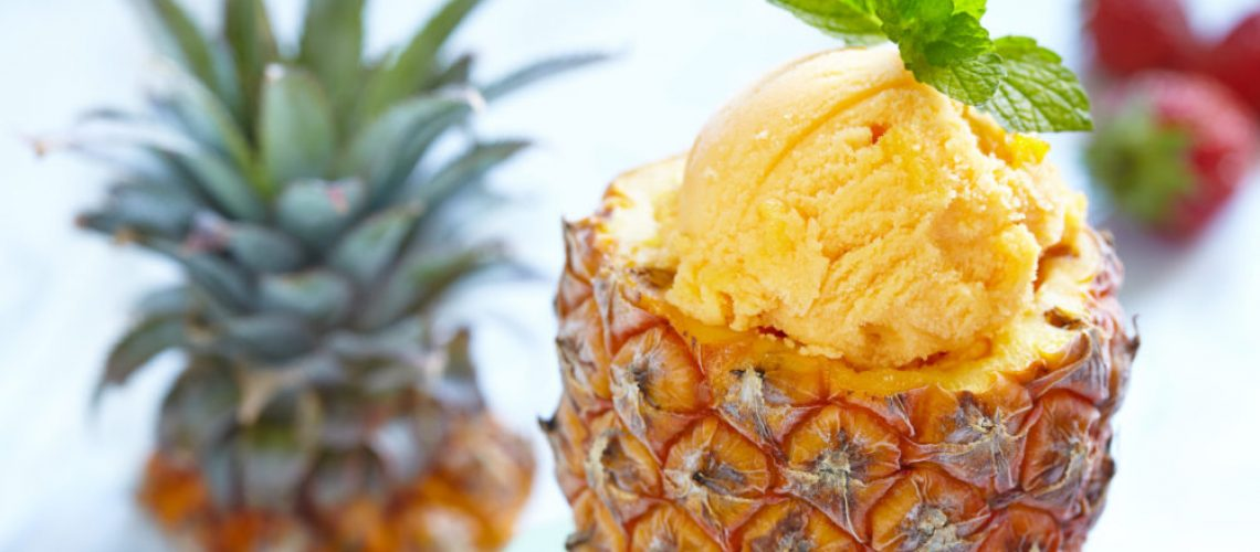 Small pineapple stuffed fruit sorbet ice cream